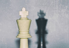 Face to face - two kings, black and white plastic chess pieces - selective focus Stock Photos