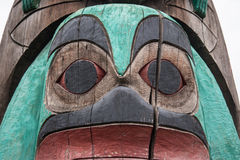 Face on a totem pole in Duncan British Columbia Canada. Detail of a totem pole in Duncan British Columbia Royalty Free Stock Photo