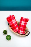 Face towels. Two red face towels in a rattan basket Royalty Free Stock Photography