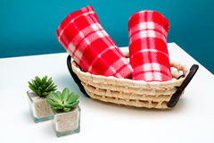 Face towels. Two red face towels in a rattan basket Stock Photos
