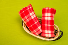 Face towels. Two red face towels in a rattan basket Royalty Free Stock Images