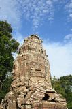 Face tower of the Ta Prohm temple in Angkor area, Cambodia. Royalty Free Stock Photos