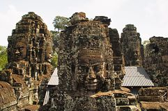 Face towers of the Bayon temple, In the center of Angkor Thom , Siem Reap, Cambodia. UNESCO World Heritage Site royalty free stock photos