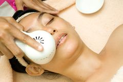 Face treatment with collagen serum Stock Photo