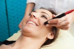 Face treatment Stock Photos