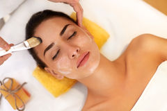 Face Treatment. Woman in Beauty Salon Gets Marine Mask Stock Photo