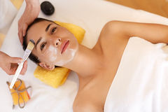 Face Treatment. Woman in Beauty Salon Gets Marine Mask Stock Photos