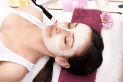 Face Treatment. Woman in Beauty Salon Gets Marine Mask Stock Image
