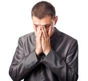 Face triste da coberta do homem de negócios pelas mãos Foto de Stock Royalty Free