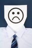 Face triste de papel Imagens de Stock