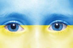 Face with ukrainian flag. Human`s face with ukrainian flag Stock Photos