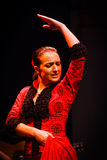 Face and upper body Flamenco dancer in red dress. Flamenco dancer performs traditional step in classical red dress costume, hairstyle and form on May 1, 2010 in Stock Photo