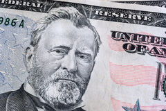 Face on US fifty or 50 dollars bill macro, banknotes background. `Ulysses S. Grant` face on US fifty or 50 dollars bill macro, banknotes background, american royalty free stock photo