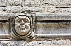 A Face in the Wall. A face embedded in the architecture of a building wall Stock Images