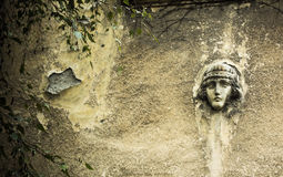 Face in the Wall. A face carved in stone on an old house in Belgrade Stock Images