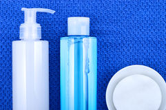 Face wash cleansing gel, toner and cotton cleansing pads. Stock Photos