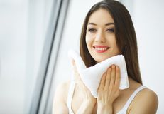 Face Washing. Happy Woman Drying Skin With Towel.  stock photo