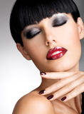 Face of a woman with beautiful dark nails and sexy Stock Photography