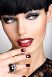 Face of a woman with beautiful dark nails and sexy Royalty Free Stock Image