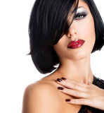 Face of a woman with beautiful dark nails and sexy red lips Stock Photo