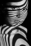 The face of woman with black and white zebra Stock Photo