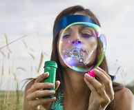 Face of woman that blows soap bubbles Royalty Free Stock Photo