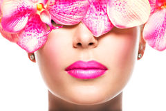 Face of  woman with bright lipstick on a lips and pink flowers Stock Images