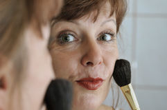 face of woman with brush Royalty Free Stock Photos
