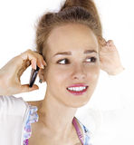 Face of woman with cell phone Stock Images