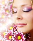 face of woman with chrysanthemum Stock Photography