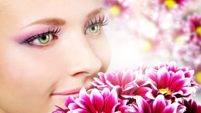 face of woman with chrysanthemum Royalty Free Stock Image