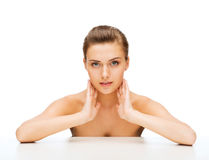 Face of woman with clean perfect skin Stock Images
