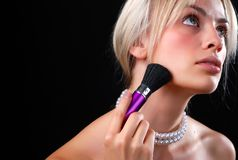 Face of woman and cosmetic brush Royalty Free Stock Photos