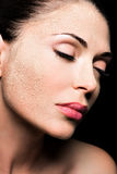 Face of a woman with cosmetic powder on skin Stock Photography