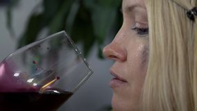 Face of woman when drinking wine stock footage