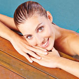 Face of woman on edge of swimming Stock Photos