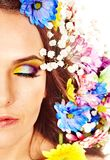 Face of woman with flower. Stock Image