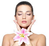 Face of woman with flower. Beauty treatment royalty free stock photo