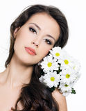 Face of woman with flowers Stock Photo