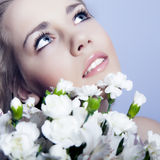Face of woman with flowers Stock Image