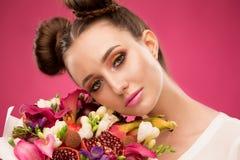 Face woman, fruit bouquet, pink stock images