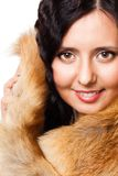 Face of a woman with fur Stock Photos
