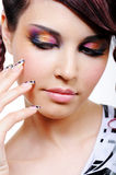 Face of woman with multicolored eyeshadows Royalty Free Stock Photos