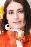 Face of a Woman with Orange Accessories Royalty Free Stock Photos