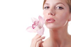 Face of woman and orchid Royalty Free Stock Image