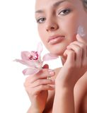 Face of woman and orchid. Face of beautiful young woman with delicate orchid Stock Images