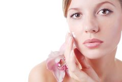 Face of woman and orchid Stock Images