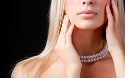 Face of woman and pearl necklace. Face of beautiful young woman with pearl necklace Royalty Free Stock Images