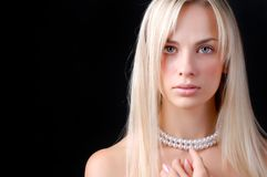 Face of woman and pearl necklace. Face of beautiful young woman with pearl necklace Stock Photo