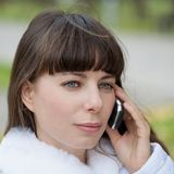 Face woman with phone and blue eyes Royalty Free Stock Photo